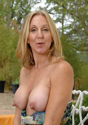 Busty mature woman with large nipples